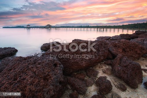 Sunset time with long wooden bridge in beautiful tropical island beach - Koh Mak in Trat, Thailand.