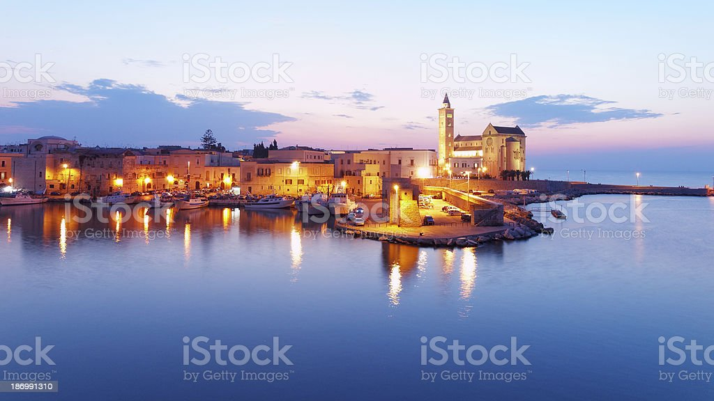 Sunset Trani's harbor Italian landscape view stock photo