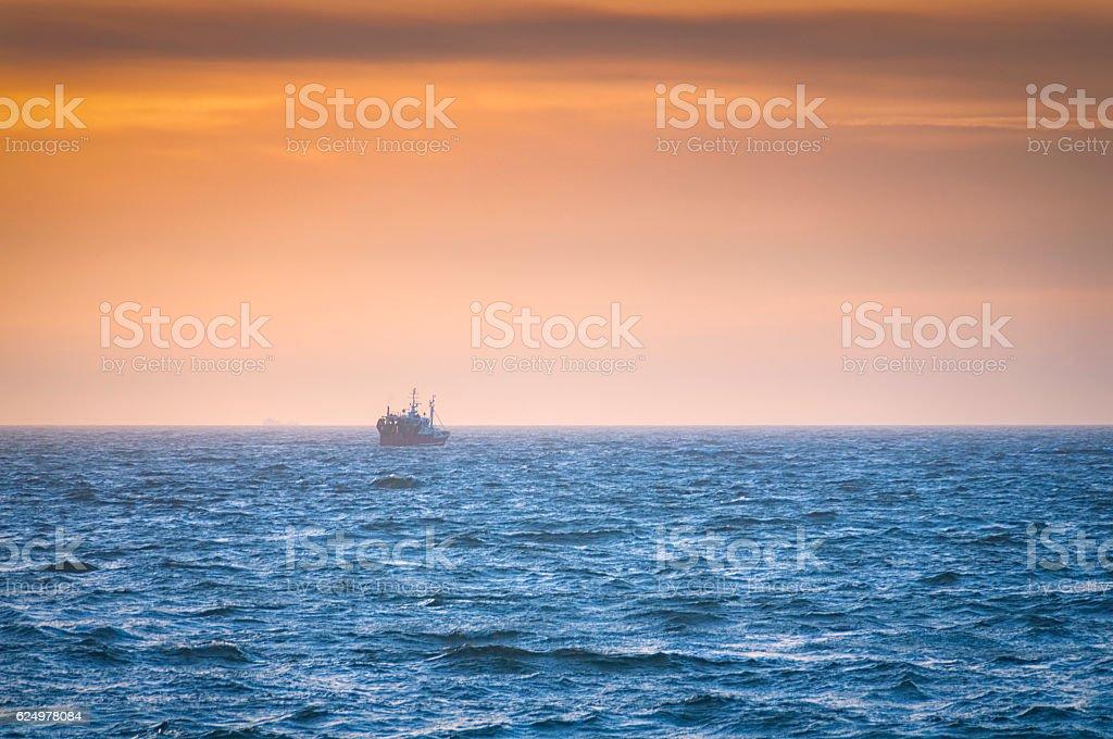 Sunset Trawler stock photo
