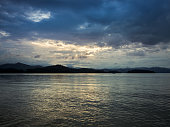 Sunset, Twilight and Cloudy Sky over a Lake in Phetchaburi, Thailand