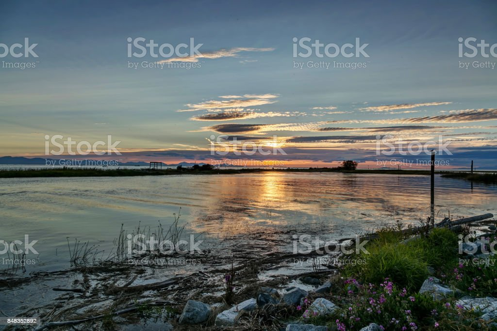 sunset view at a seaside in a park stock photo