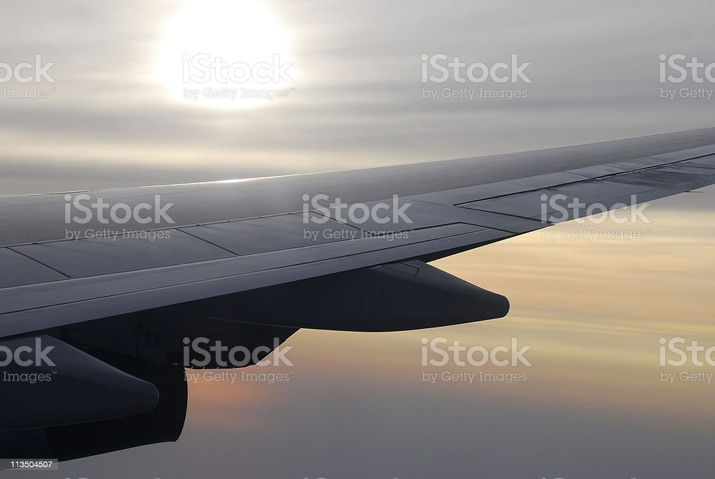 Aircraft Wing at Sunset royalty-free stock photo