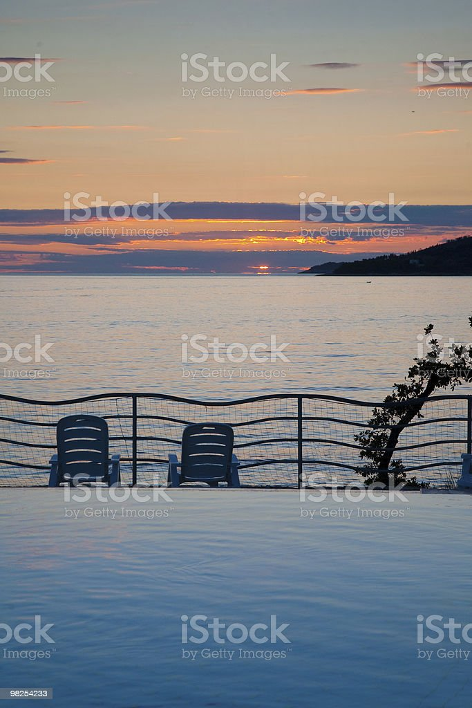 Sunset view from pool at hotel Orphee in Plat, Croatia royalty-free stock photo