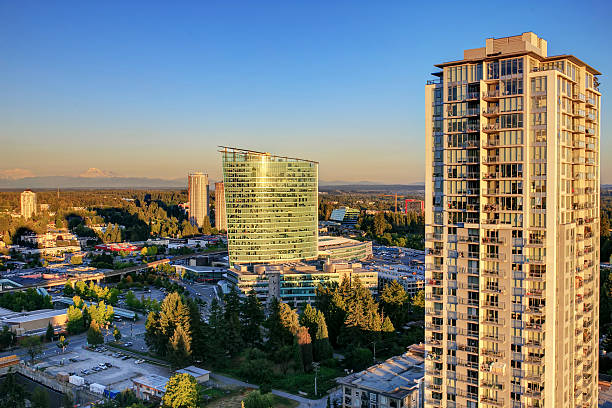 sunset view from rooftop of highrise, surrey, bc, canada - british columbia stock photos and pictures
