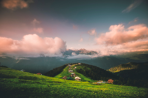 Landscape view of beautiful sunrise time with moody dramatic sky on the Pokut Highland in Çamlıhemşin, Rize in Blacksea region of Turkey on sunny summer morning