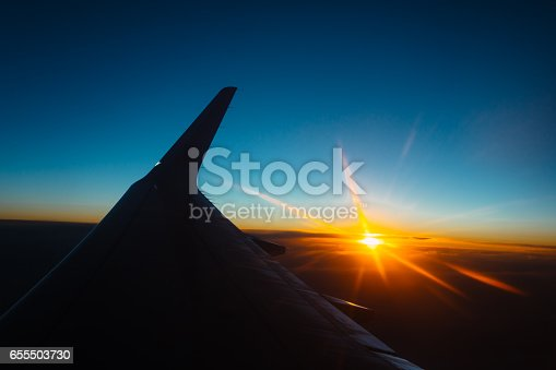 istock sunset view from the window of an airplane 655503730