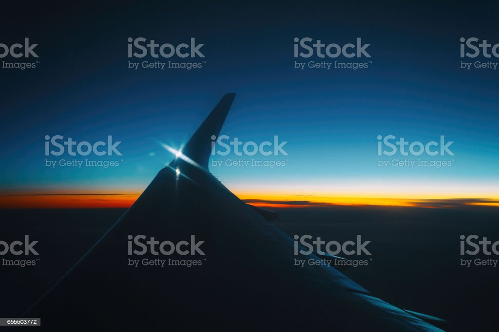 sunset view from the window of an airplane stock photo