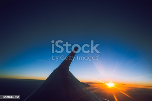 istock sunset view from the window of an airplane 655506268