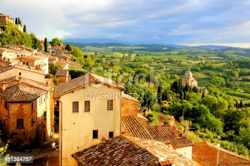 istock Sunset view of a town overlooking countryside of Tuscany, Italy 481364757