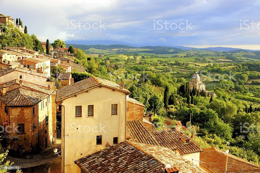Sunset view of a town overlooking countryside of Tuscany, Italy stock photo