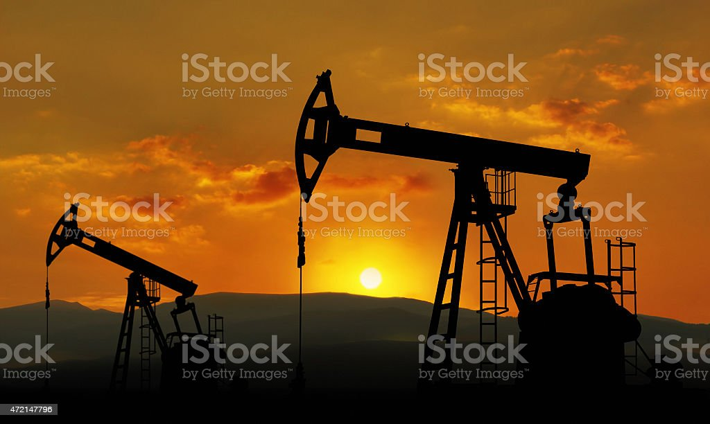 Sunset view of an oil field working nonstop stock photo