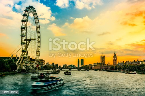 istock Sunset view of Big Ben and Houses of Parliament with Westminster bridge , London, UK 982163288