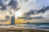 Dubai, United Arab Emirates - Jan 29, 2018 - Amazing sunset view of Burj Al Arab, Seven Star Hotel, A view from Jumeirah Beach, Arabian Sea, Residential and Business Skyscrapers, Dubai, UAE