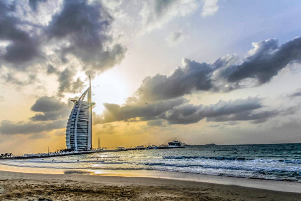 Sunset view of Burj Al Arab, Seven Star Hotel, A view from Jumeirah Beach, Arabian Sea, Residential and Business Skyscrapers, Dubai, UAE