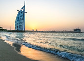 Dubai, United Arab Emirates - Jan 02, 2018 - Amazing sunset view of Burj Al Arab, Seven Star Hotel, A view from Jumeirah Beach, Arabian Sea, Residential and Business Skyscrapers, Dubai, UAE