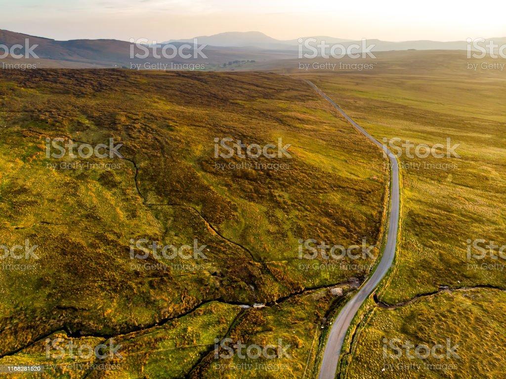 Aerial sunset view of Connemara region in Ireland. Scenic Irish...
