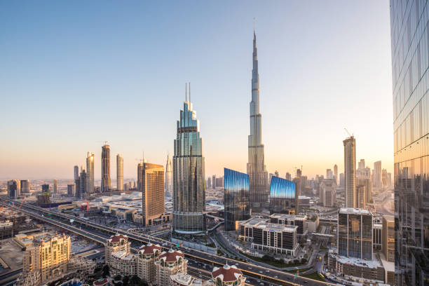 Sunset view of Dubai Downtown district. Dubai, UAE - Jan 19, 2018: Colorful sunset view of Dubai Downtown district landmarks and skyscrapers. burj khalifa stock pictures, royalty-free photos & images