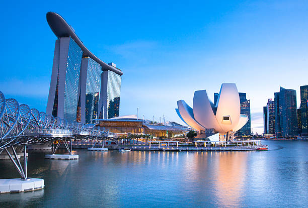 sunset view of marina bay area - marina bay sands stock photos and pictures