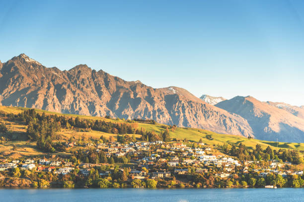 Sunset View of Queenstown and Lake Wakatipu from apartment,house at sunset Queenstown south island New zealand stock photo