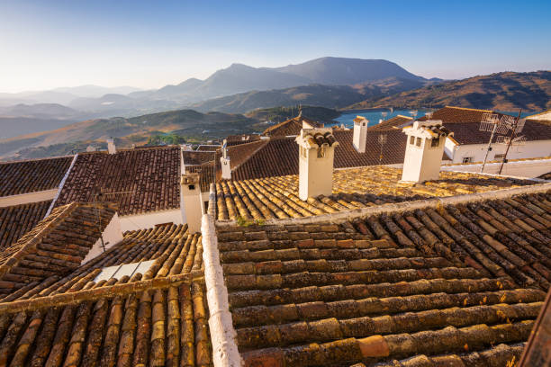 Sunset view of rooftops from Zahara de la Sierra in Spain stock photo