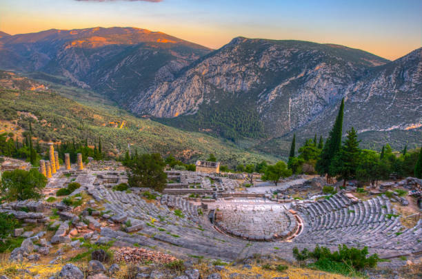 Sunset view of ruins of theatre at ancient Delphi, Greece Sunset view of ruins of theatre at ancient Delphi, Greece amphitheater stock pictures, royalty-free photos & images