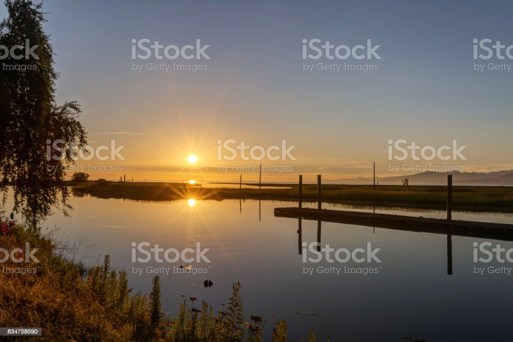 sunset view of sea inlet in a park stock photo