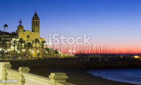 Sunset view of Sitges.  Church of Sant Bartomeu i Santa Tecla at beach. Catalonia