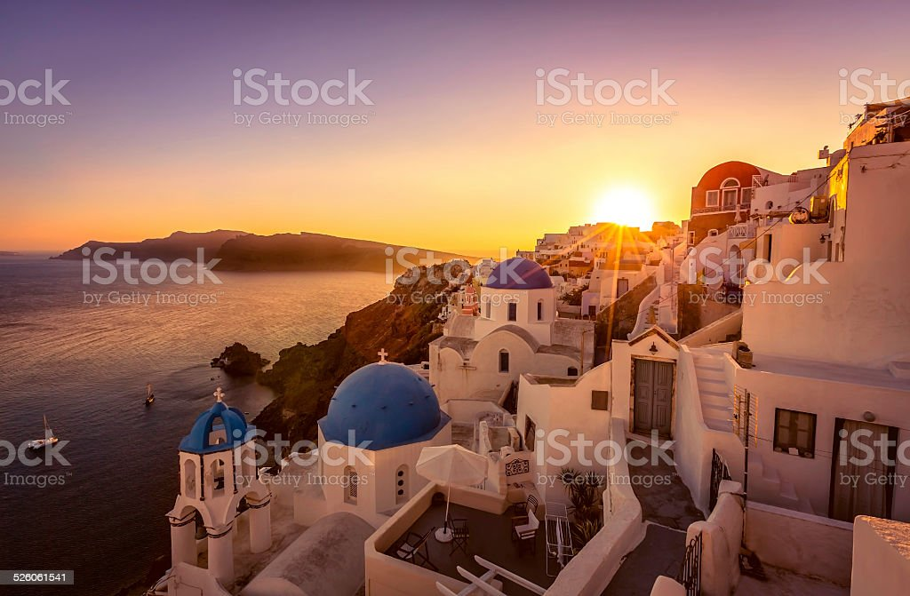 Sunset view of the blue dome churches of Santorini, Greece stock photo