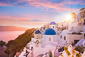 Sunset view of the blue dome churches of Santorini, Greece, Europe.