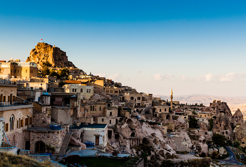 Sunset view of the fortress and the city Uchisar in Cappadocia. Anatolia, Turkey.