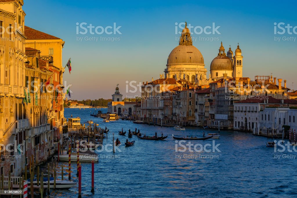 Sunset view of the iconic 17th-century Santa Maria di Salute Basilica on the Grand Canal in Venice stock photo