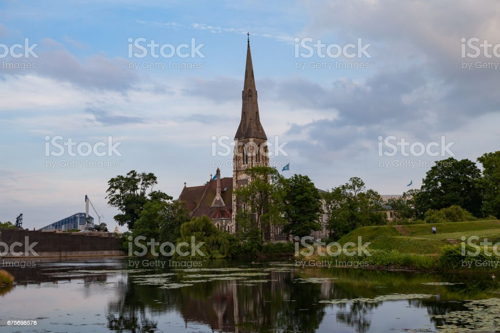 Sunset view on the St. Alban's Church and the pond in Copenhagen, Denmark royalty-free stock photo