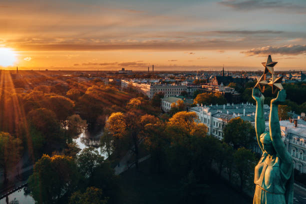 Sunset view over Riga near central park Sunset view over Riga near central park and the statue of liberty. latvia stock pictures, royalty-free photos & images