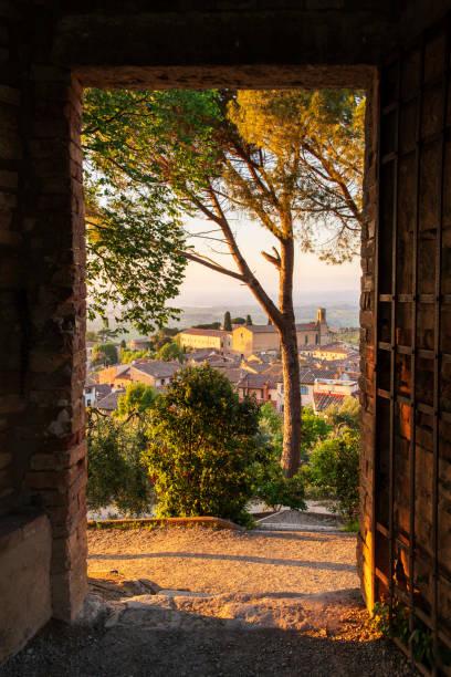Sunset view through door in San Gimignano