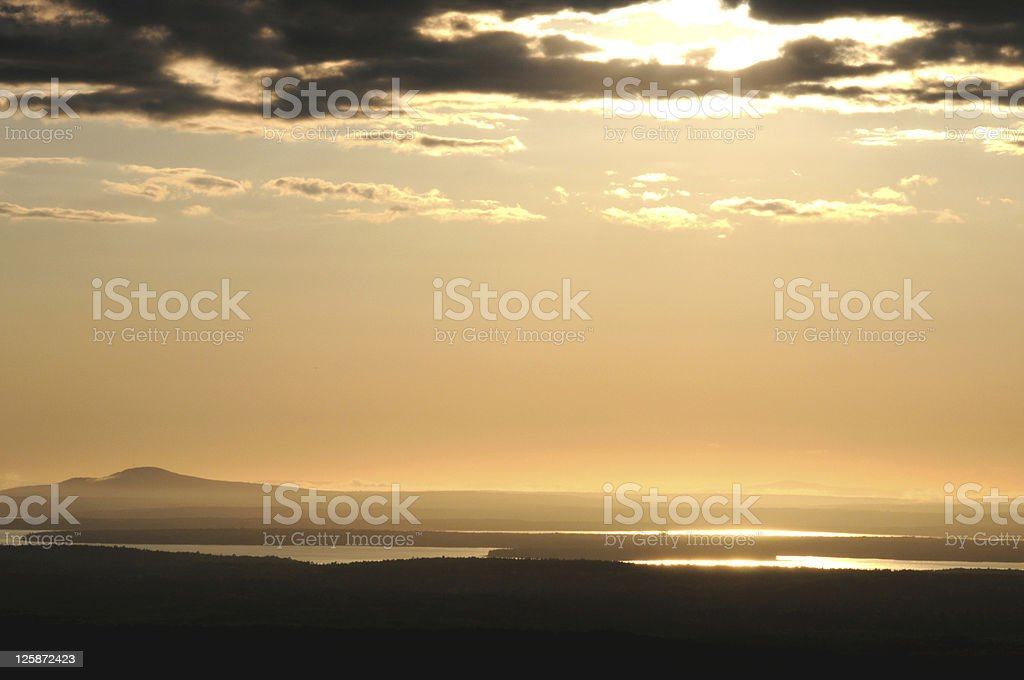 sunset viewed from Mt, Cadillac in Acadia NP stock photo