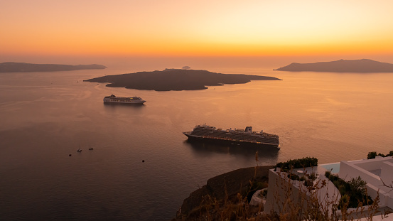 Fira, Santorini, Greece - 14th October, 2019: Holidaymakers from all over the world visit Fira, on the island of Santorini in Greece, to enjoy some of the best sunset vistas in the world.