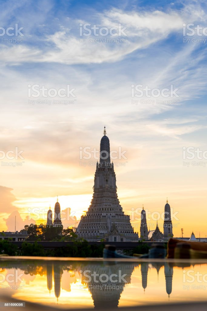 Sunset Wat Arun (Temple of Dawn) and Reflections of Wat Arun Pagoda on glass table is landmark of Attractions's Popular tourists, in bangkok Thailand stock photo