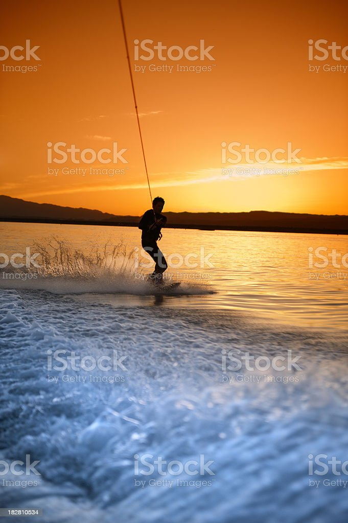 Sunset Waterskiing stock photo