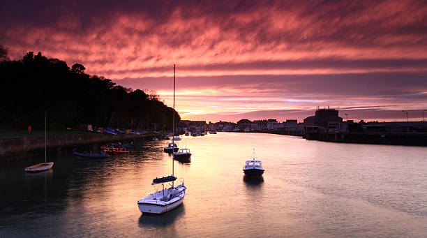 sunset weymouth harbour england - weymouth stock photos and pictures