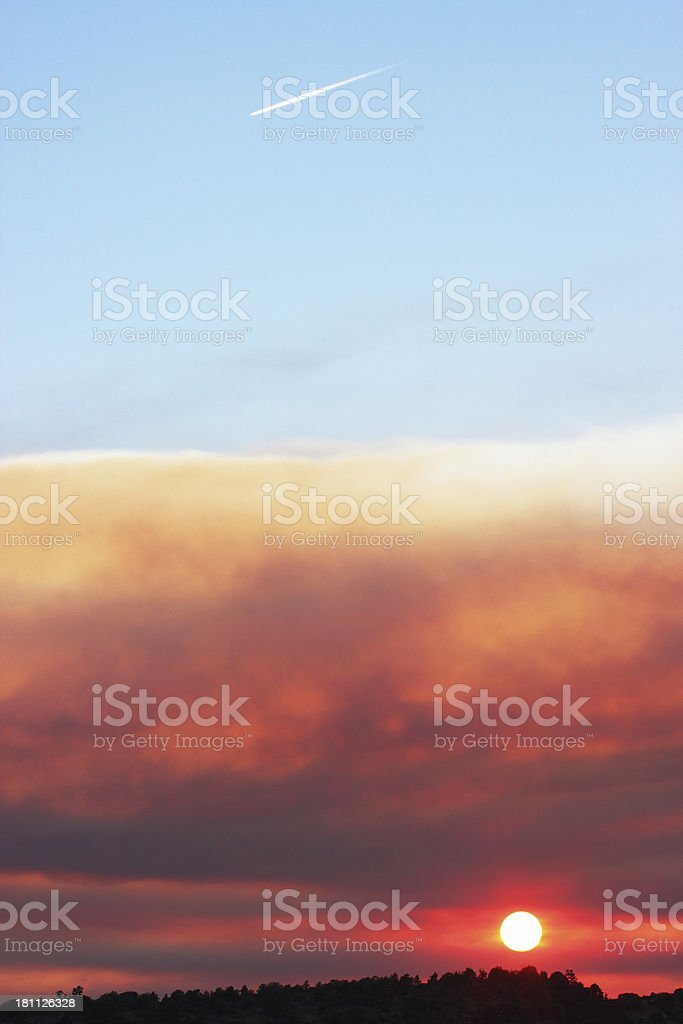 Sunset Wildfire Smoke Cloudscape Vapor Trail royalty-free stock photo