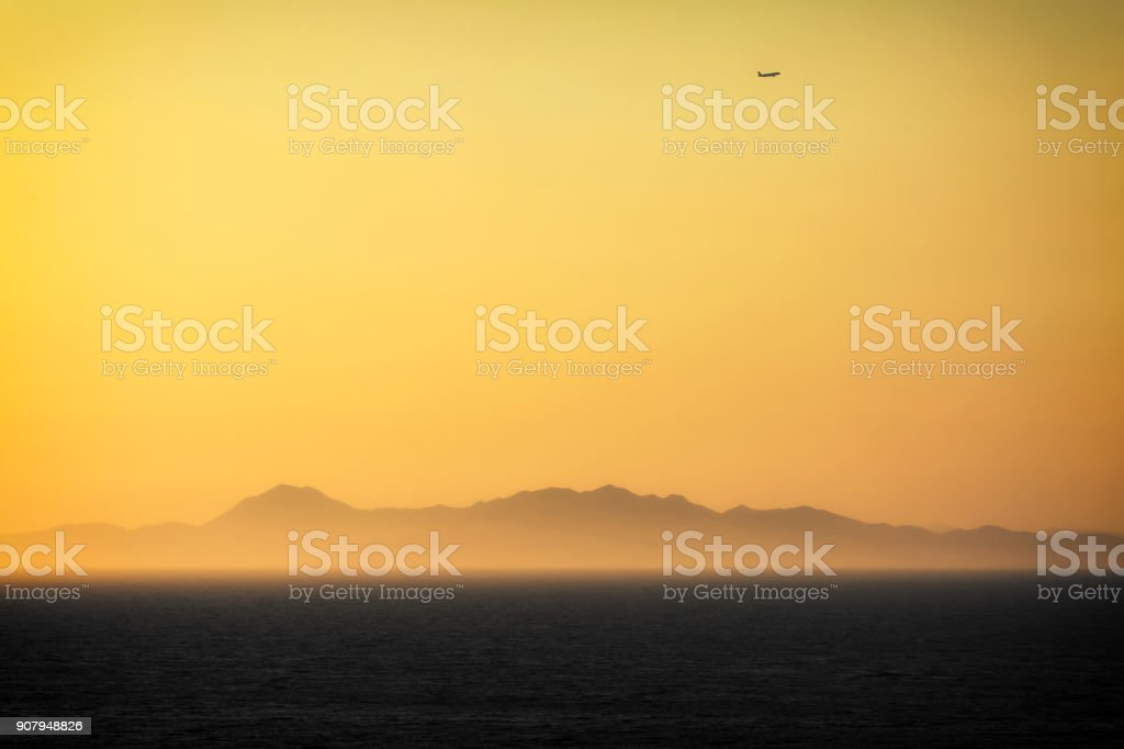 Sunset with aircraft silhouette stock photo