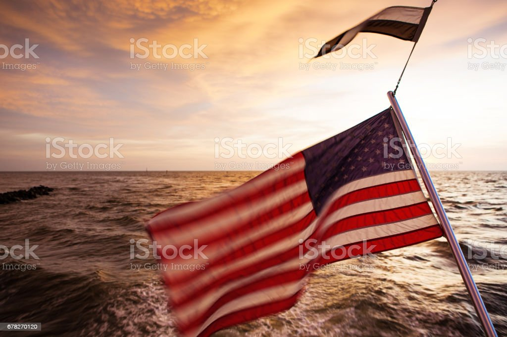 Sunset with american flags stock photo