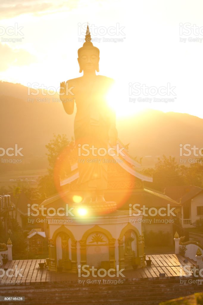 Sunset with Buddha Statue Muang Xai, Laos stock photo