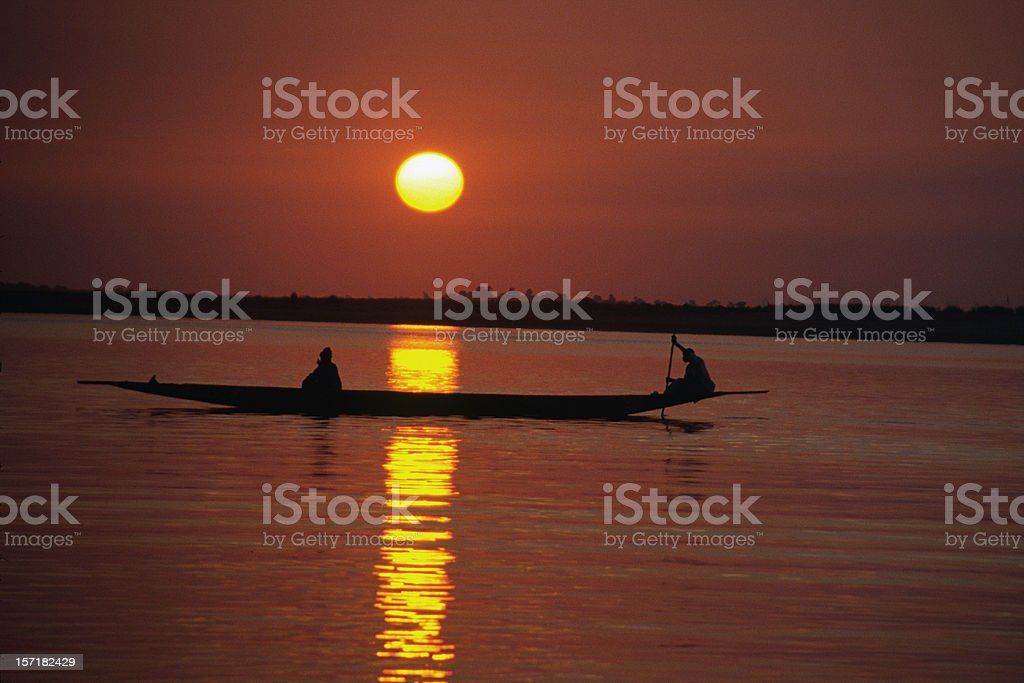 Sunset with Canoe on the Niger River royalty-free stock photo