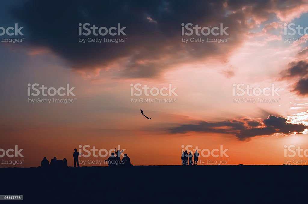 Sunset  with child flying kite. royalty-free stock photo