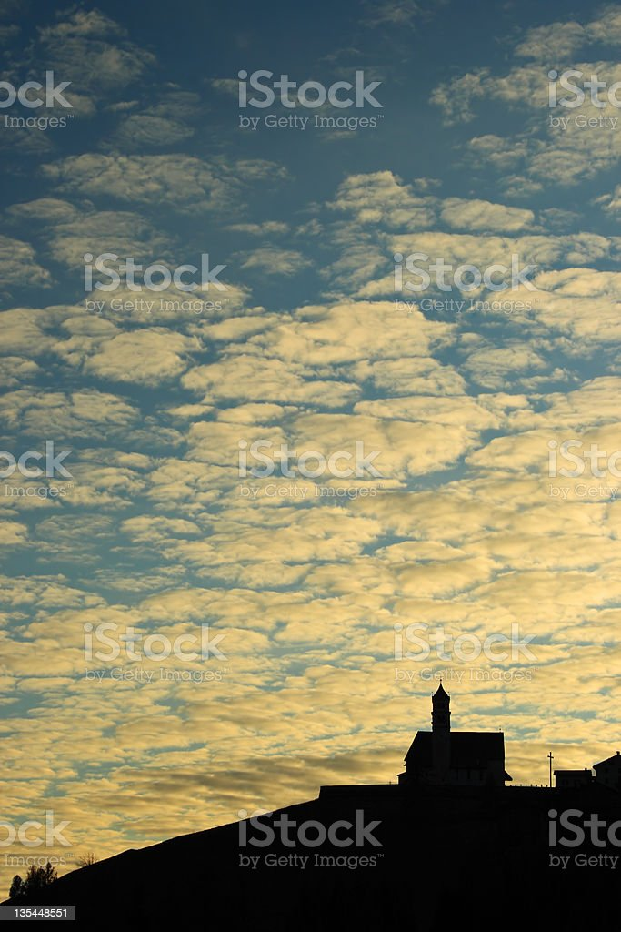 Sunset with church silhouette stock photo