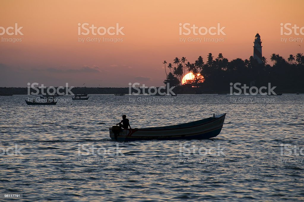 Sunset with man on boat. royalty-free stock photo