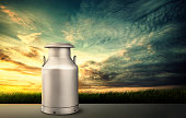 Sunset with milk can in village background