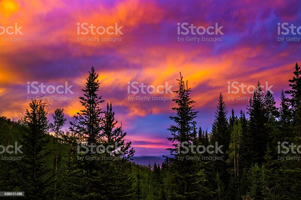 Sunset with Mountain View and Dramatic Colorful Clouds royalty-free stock photo