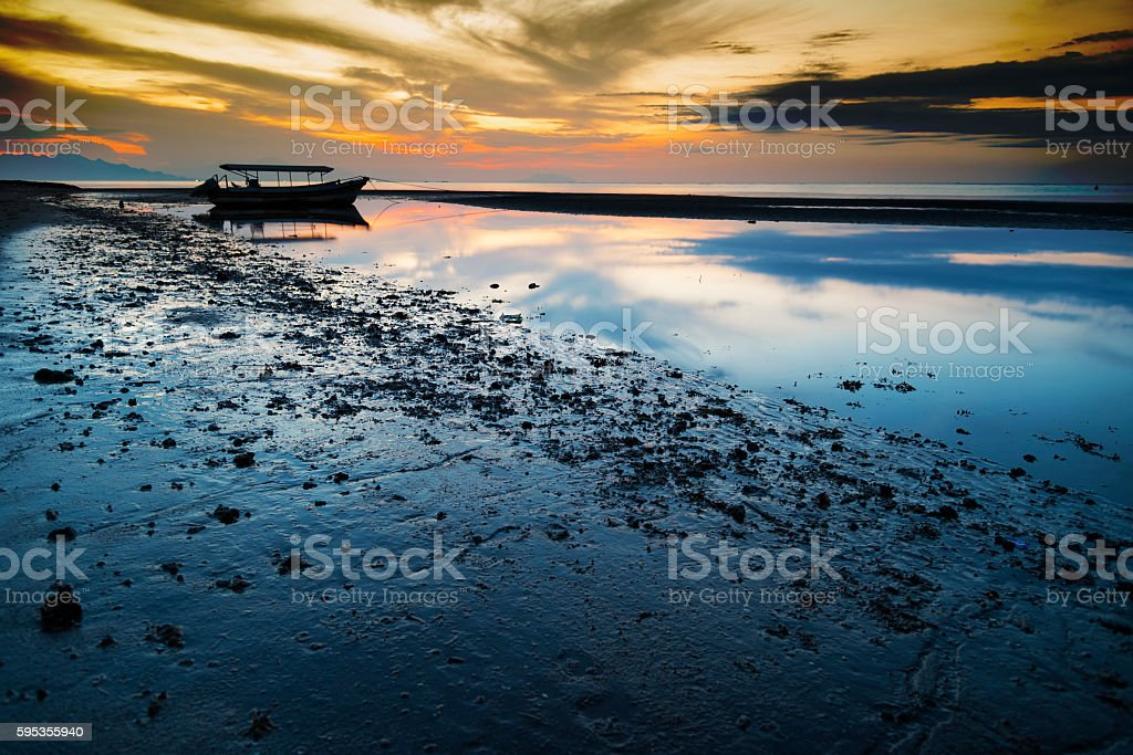 Sunset with old fisherman boat, Java, Indonesia stock photo
